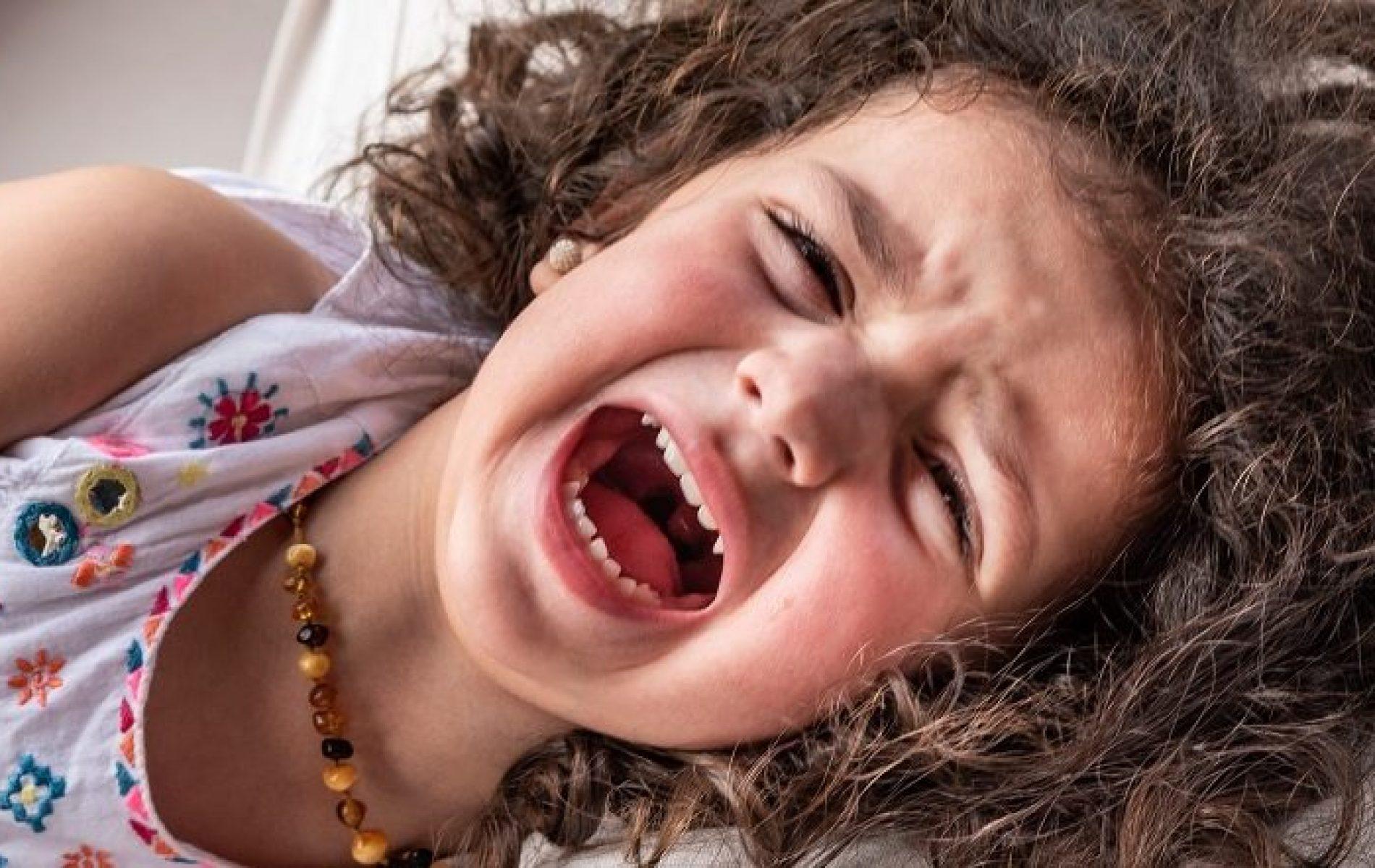 girl lying down having temper tantrum